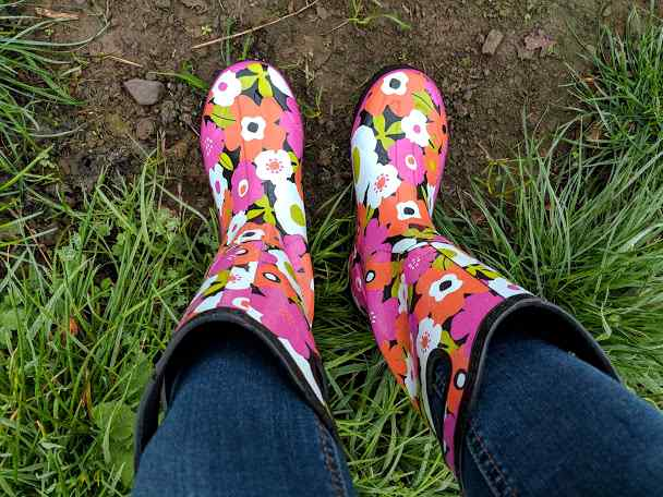 Image of floral patterned waterproof boots photographed on feet from above