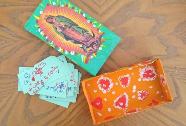 Image of hand painted matchbox in orange and blue with red roses and hearts and picture of Our Lady of Guadalupe