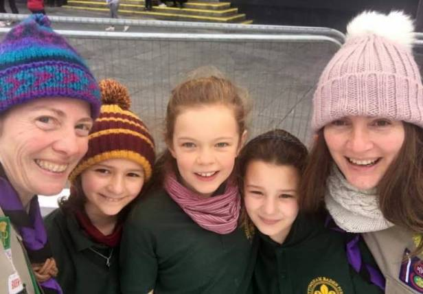 Image of selfie of two women and 3 girls in woolly hats