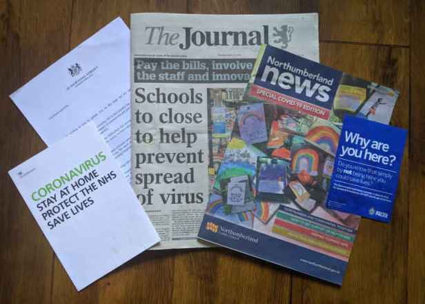 Various newspapers and leaflets about Coronavirus Covid-19 safety in the UK