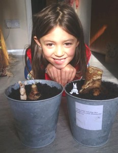 girl-with-2-pots-of-newly-planted-bulbs