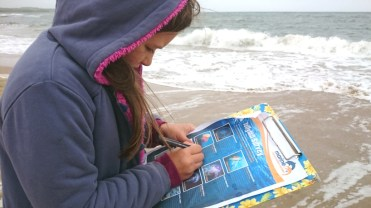 girl-with-sea-behind-completing-jellyfish-survey