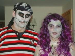man-in-pirate-skeleton-costume-and-woman-in-purple-wig-halloween-costume