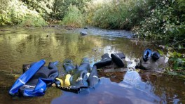wetsuits-rinsing-in-a-stream
