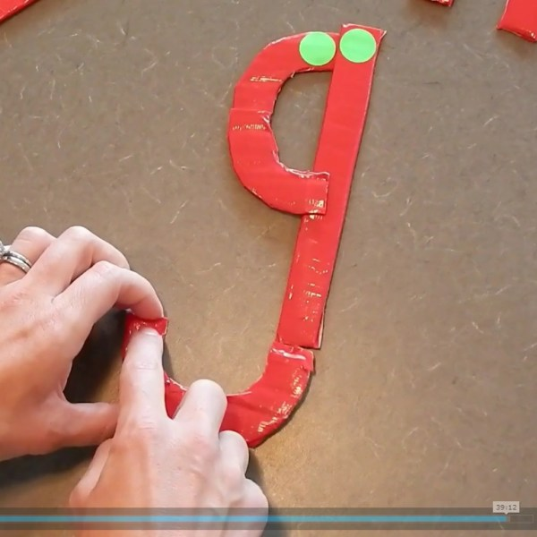 how to teach handwriting to kids movie screenshot of making letters with manipulatives