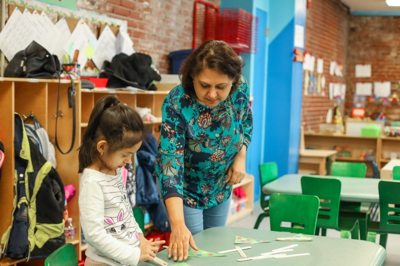 Ms. Anju working with a preschool student