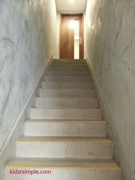 This staircase leads up to the party room, which has a door to shut off all loud excited voices from the children.