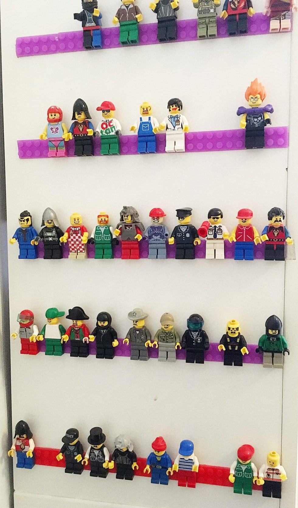 LEGO minifigs on display using LEGO tape