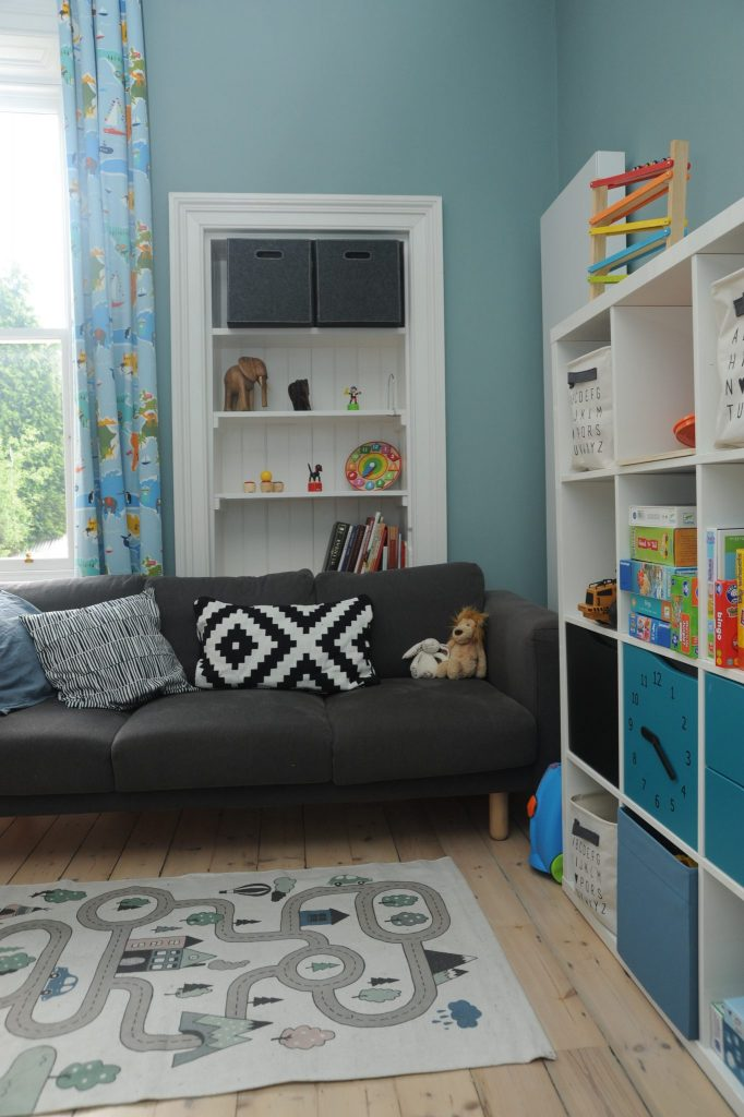 Corner of James' room with sofa and cube storage