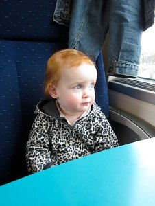 Baby Z on the train to Lille in France which is about 50 miles from Ghent- Kid World Citizen