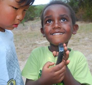 Boys Learning to Geocache- Kid World Citizen