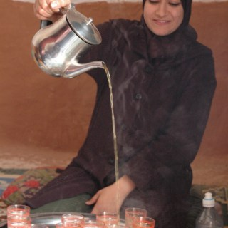 Serving Moroccan Tea Minttea- Kid World Citizen