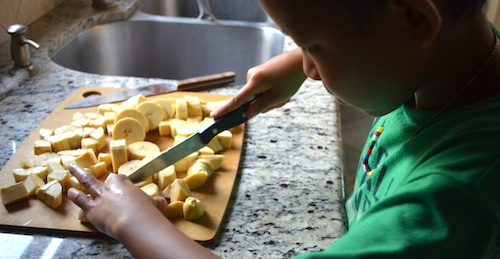 Chopping Plantains for Kelewele- Kid World Citizen