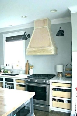 16 Kitchens With Unusual Stove Hoods 11