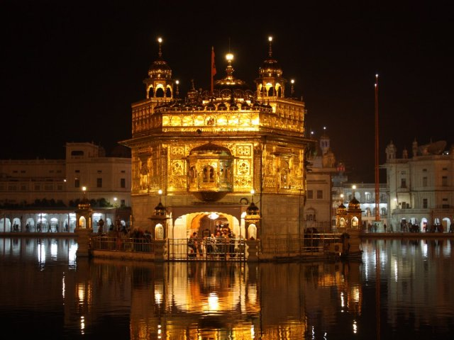the-golden-temple-in-amritsar-india-is-a-stunning-structure-that-seems-to-have-been-dropped-right-in-the-middle-of-the-amritsar-river
