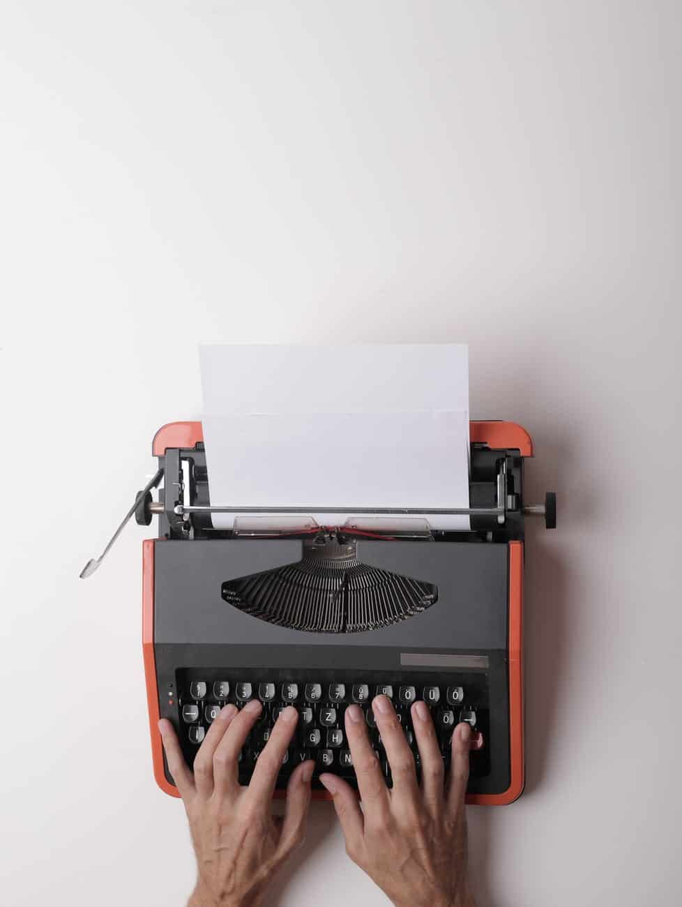 Short Story Compilation writer working on typewriter in office
