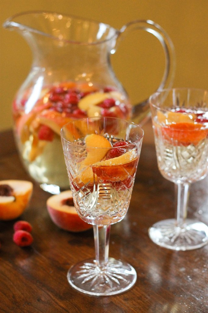 Peach sangria with sparkling juice and white wine