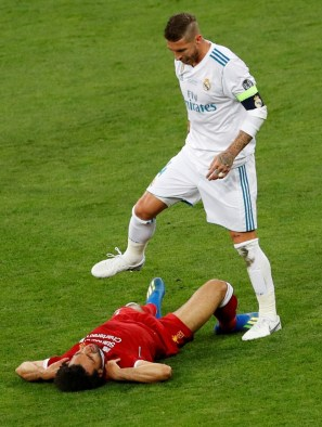 Soccer Football - Champions League Final - Real Madrid v Liverpool - NSC Olympic Stadium, Kiev, Ukraine - May 26, 2018 Liverpool's Mohamed Salah after sustaining an injury as Real Madrid's Sergio Ramos looks on REUTERS/Phil Noble