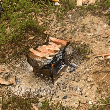 Cooking bacon on a stone using KIHD Stove