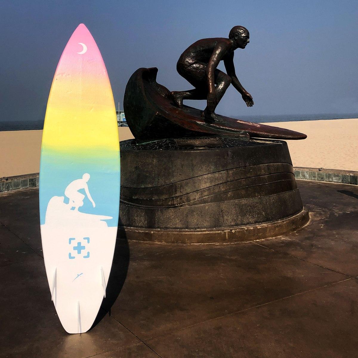 tim kelly statue surfboard art by kikicutt
