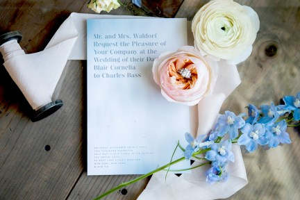 wedding invite and wedding ring