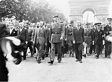 General de Gaulle leaving the Arc de Triomphe to march in triumph to the Place de la Concorde, August 26, 1944