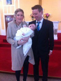 Oisin with his parents on his baptism day.