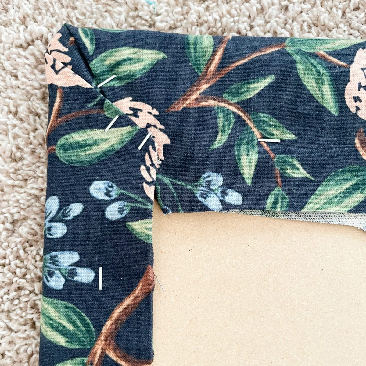 wrap the canvas around the ironing board and staple gun the fabric in place