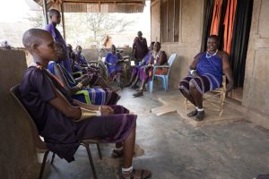 Tupendane pastoralist group gathering in a veranda's shade