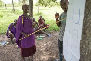 SAT facilitator and pastoralist learner going through the five vowels