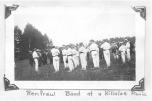 """Church Picnics 1900-1922.At their peak, two to four thousand people arrived in Killaloe for the annual church picnic. Crowds came from Ottawa and points east and west by train; return fare to Ottawa was about one dollar. Others traveled 30 to 40 miles by horse or horse and buggies and wagons.The Renfrew Pipe Band would lead the crowd up to the picnic grounds where food was served from early in the day until late evening. There were soft drinks and ice cream and a sign which read """"Lemonade Served in the Shade"""". There were speeches by members of parliament, fiddling and old time dancing contests, baseball games and horse races. Pearl Murack Collection."""