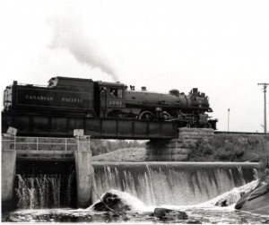 Photo of Canadian Pacific #1201 crossing Brennan's Creek. This is perhaps the last train through Killaloe. Note that it is a C.P. train travelling on what were originally C.N. tracks. Pearl Murack Collection.