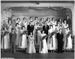 St. Andrew's Grade 12 and 13 Graduates 1952. Betty Mullin Collection.Back row, left to right, Desmond Prince, Teresa Mullin, Donna Foy, Betty Sullivan, Eileen Scully, Isobel Holly, Joan Sullivan, Marion Getz, Teresa Chapeskie, Walter Bloedow; middle row, left to right, Martina O'Grady, Mary Hennessey, Donald Wallbridge, Joan Smaggus, Dennis Anderchek, Goldie Griffith, Marie Bozek; bottom row, left to right, Dorothy Lorbetskie, Joe May, Lillian May, Christina O'Reilly, Celeste Costello, Erva Weber, Douglas Moore, Marie Cybulskie.