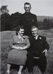 unidentifed couple with man behind them outside