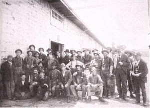 Photo taken at a J. R. Booth Lumber Camp. Daniel Costello standing in front row second from right. Private Collection.