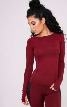 Pretty Little Thing Siania Berry Long Sleeve Gym Top, €21 https://ie.prettylittlething.com/siania-berry-long-sleeve-gym-top.html