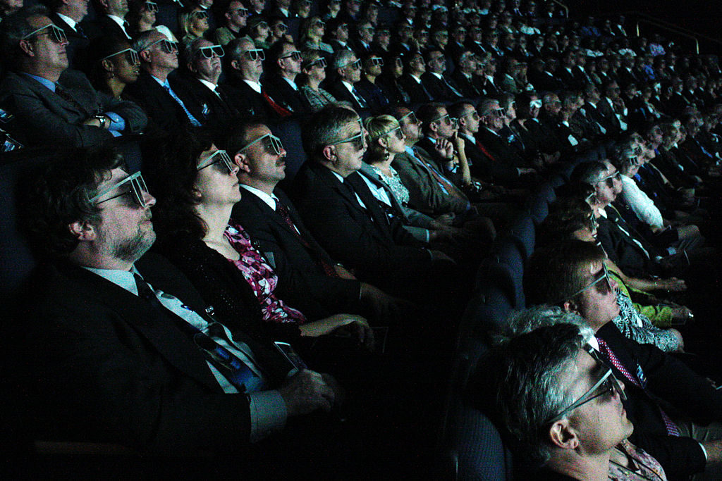 Imagine all these 3D glasses replaced with VR headsets.
