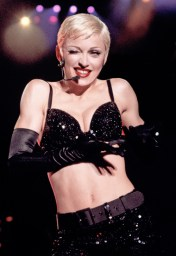 "September 1993, London, England, UK --- Madonna sings and dances in black bra and hot pants in her ""Girlie Show"". --- Image by © Neal Preston/CORBIS"