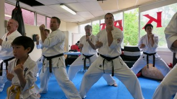 Supporting black belts train with those grading.