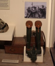 trench binoculars, two long cylindars attached to a camera-like body, encased in leather