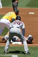 Brantley hustles back to first base