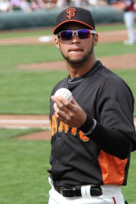 Gregor Blanco prepares to toss a ball to fans.