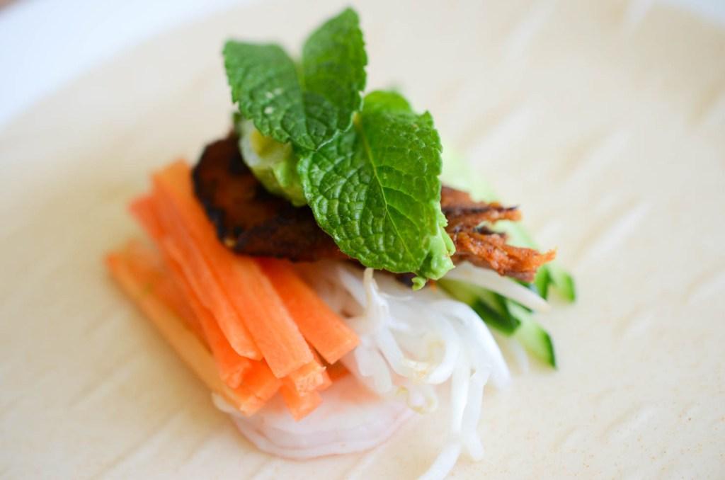 Pork bulgogi, carrots, shrimp, bean sprouts, cucumber, avocado and mint for spring roll