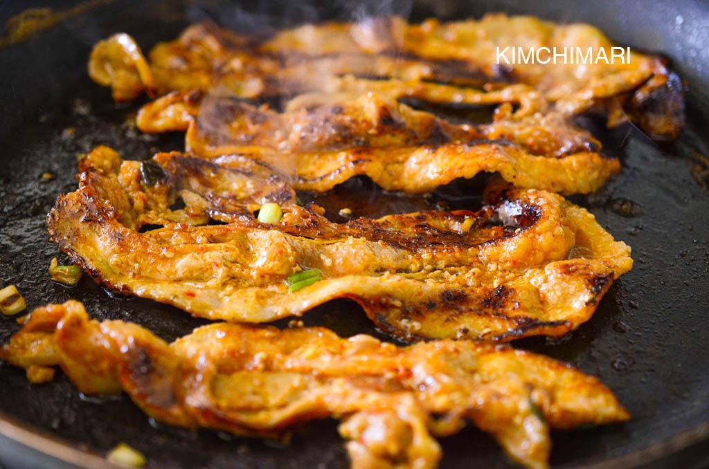 Pork belly bulgogi frying in pan