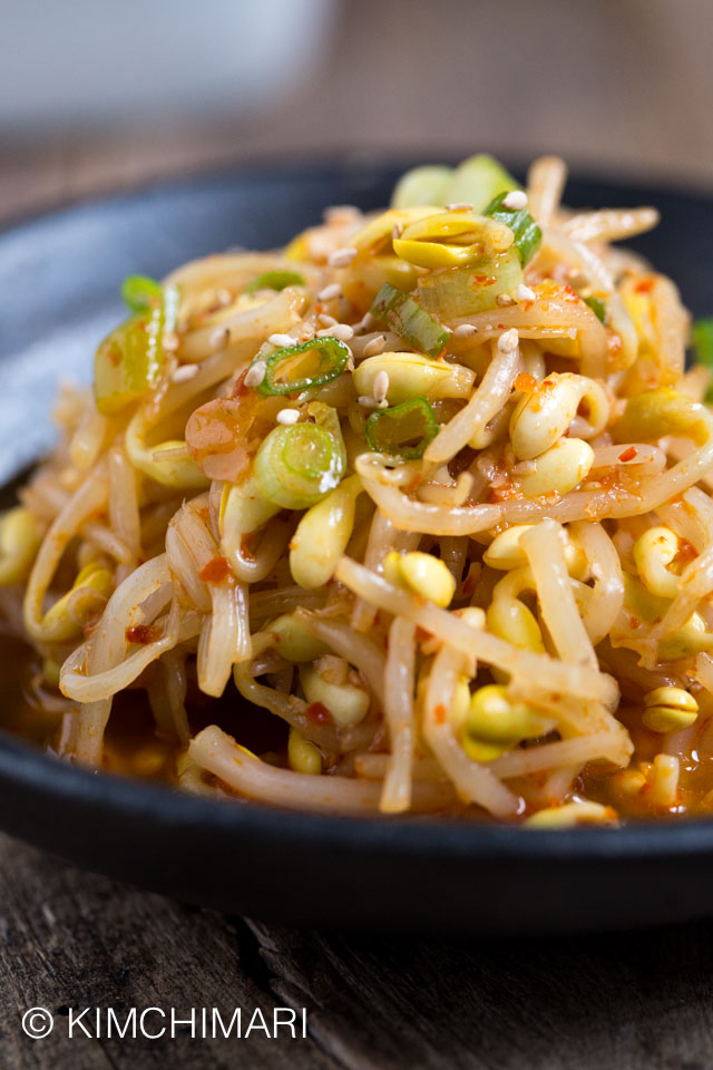 Kongnamul Muchim (Spicy Soybean Sprouts) closeup plated on black plate