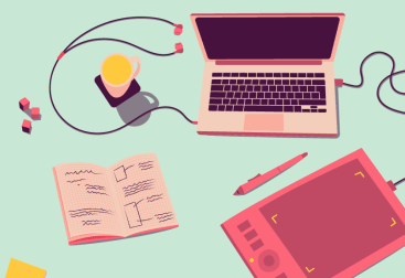 Desk with a laptop, drawing tablet and pen, notebook, cup, earphones, dice, and post-it notes