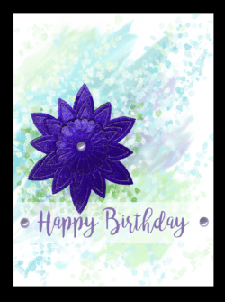 birthday card with watercolor background and layered cut out glitter flower in purple