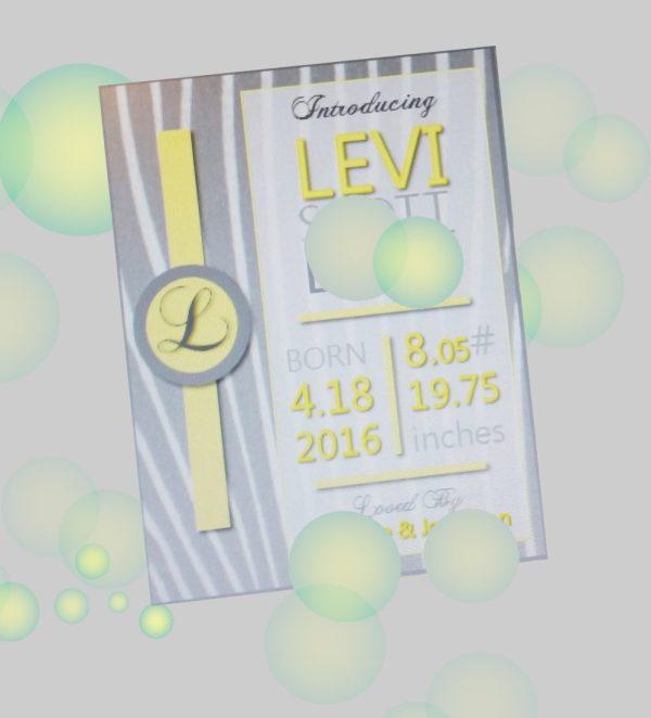 birth announcement, yellow print on gray background, monogram