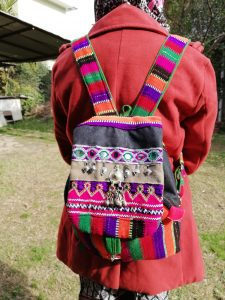 Hand Woven Back Pack with Traditional Embroidery and Embellishments.