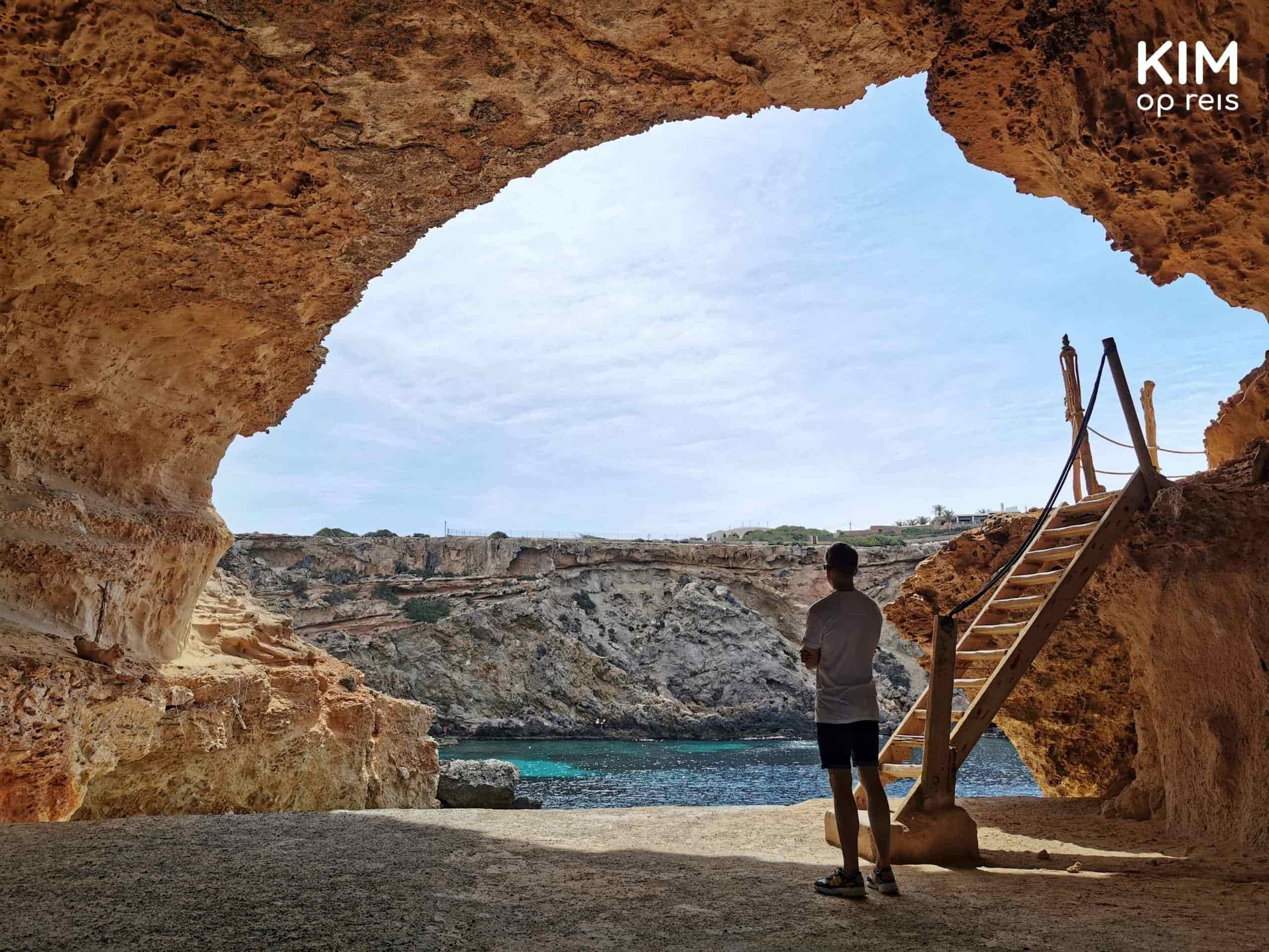 Rave Cave Ibiza: a man standing in the cave